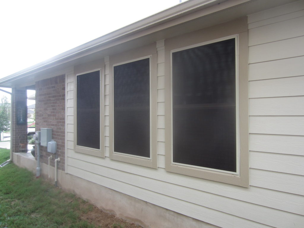For this vinyl window solar screens installation, we installed three 80% solar window screens on the left side of this home.