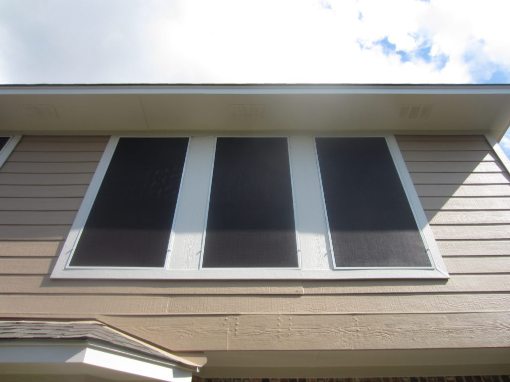 Three 90% solar screens on the back of this home.